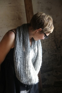 Suvi Helander wears her design as a cowl and a shoulder-hugging wrap.